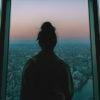 woman-looking-at-tokyo-skyline