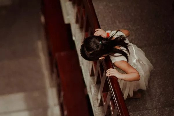 girl-looking-down-stairs