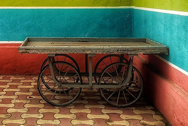 cart-against-multicolored-wall